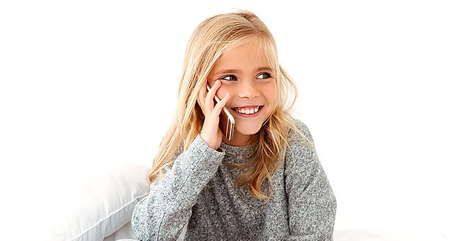 A photo of a young girl on the phone. | Photo: Shutterstock