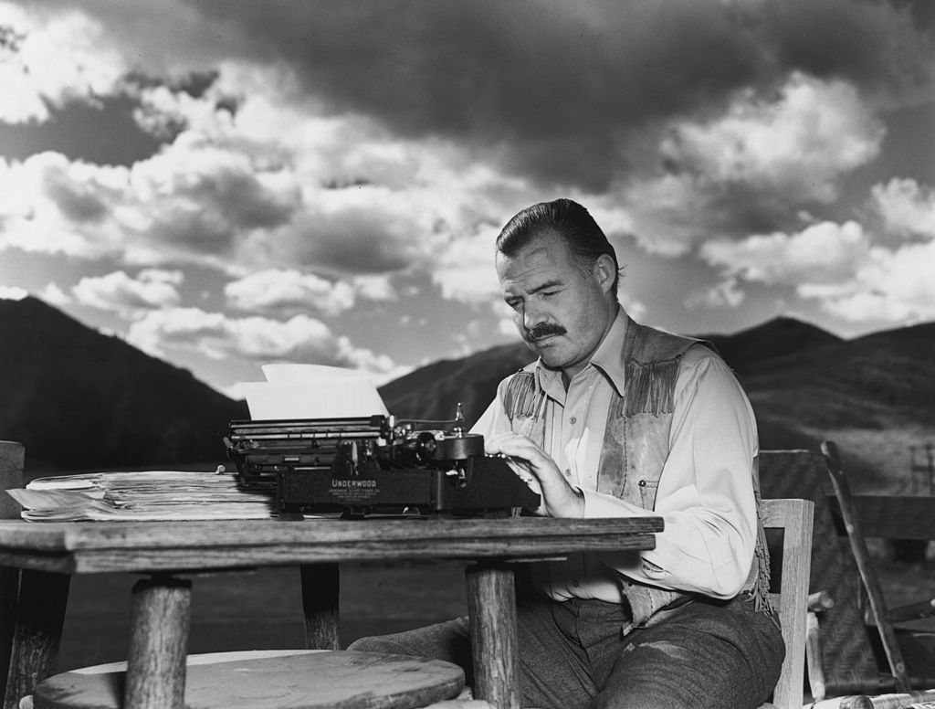 Ernest Hemingway pictured at his typewriter working outside, 1939.   Photo: Getty Images
