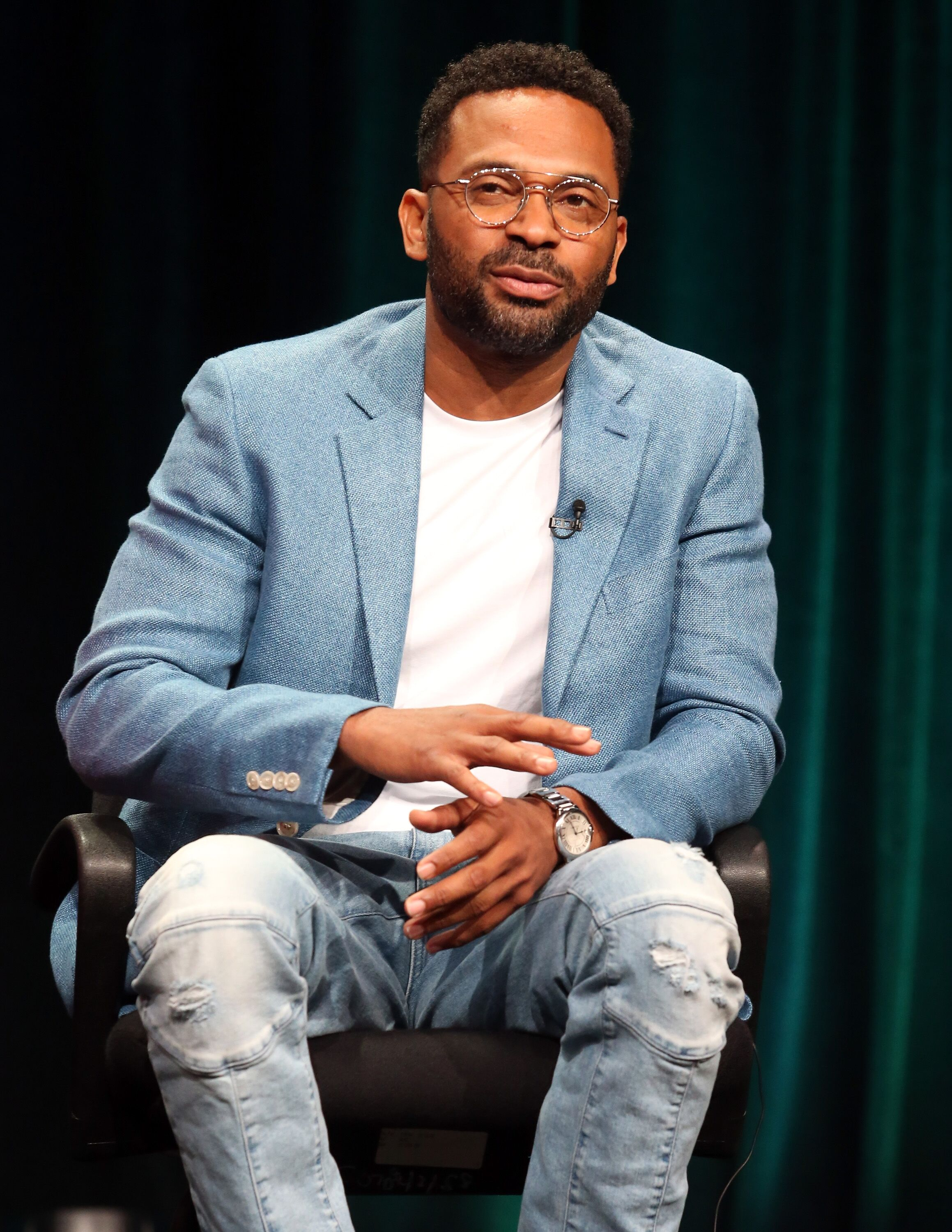 Mike Epps speaks onstage during the 'Survivor's Remorse' panel discussion at the STARZ portion of the 2015 Summer TCA Tour at The Beverly Hilton Hotel on July 31, 2015 in Beverly Hills, California. | Source: Getty Images