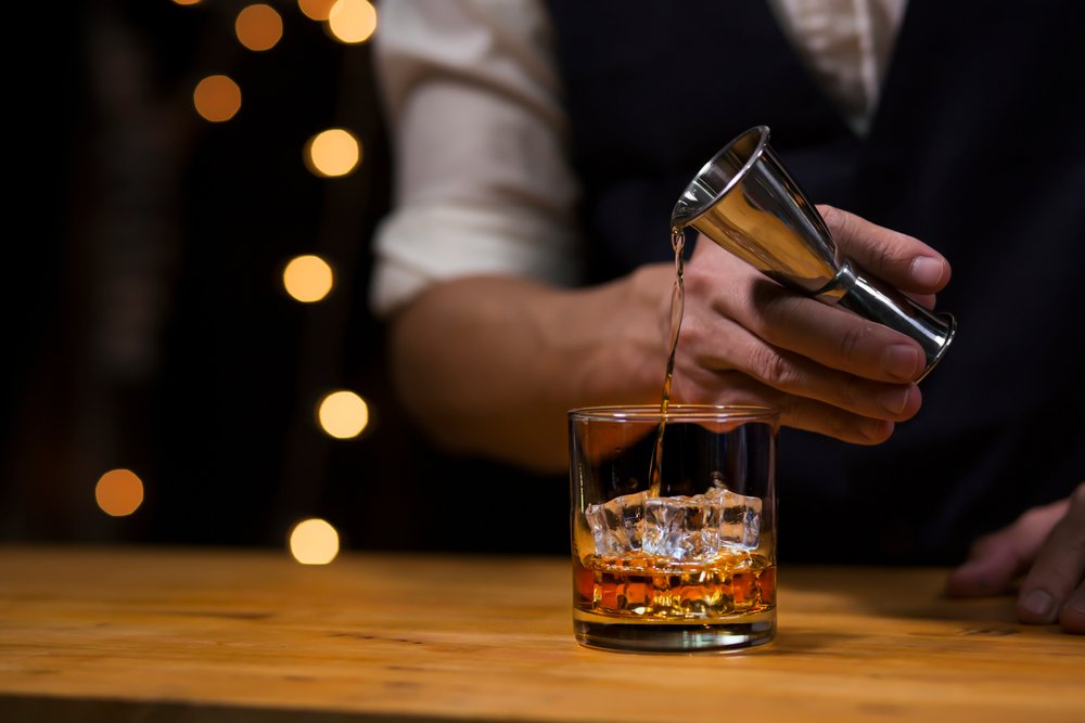 A photo of a bartender pouring a drink in a glass   Photo: Shutterstock