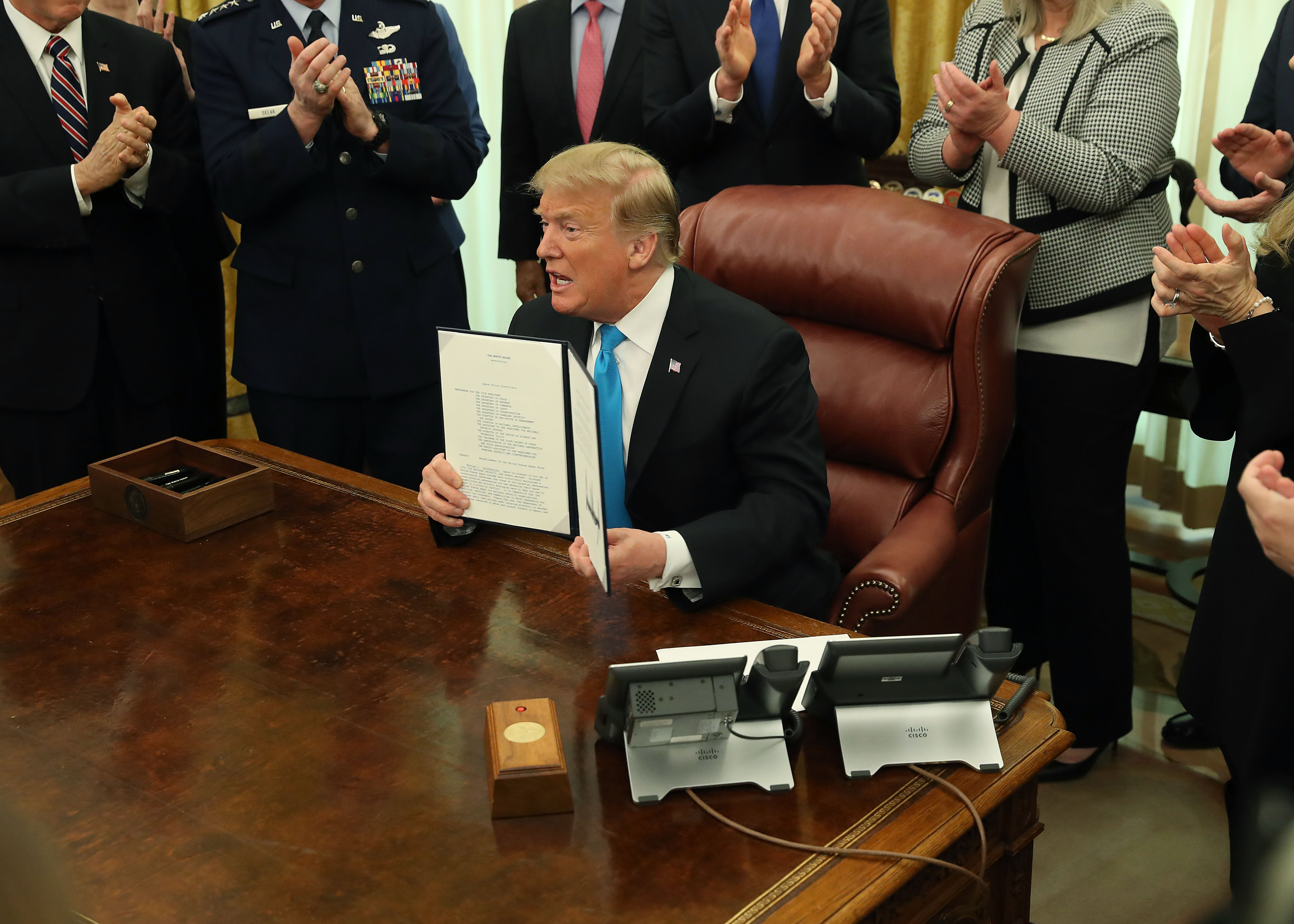 President Donald Trumpafter signing the Space Policy Directive 4 at the Oval Office | Photo: Getty Images