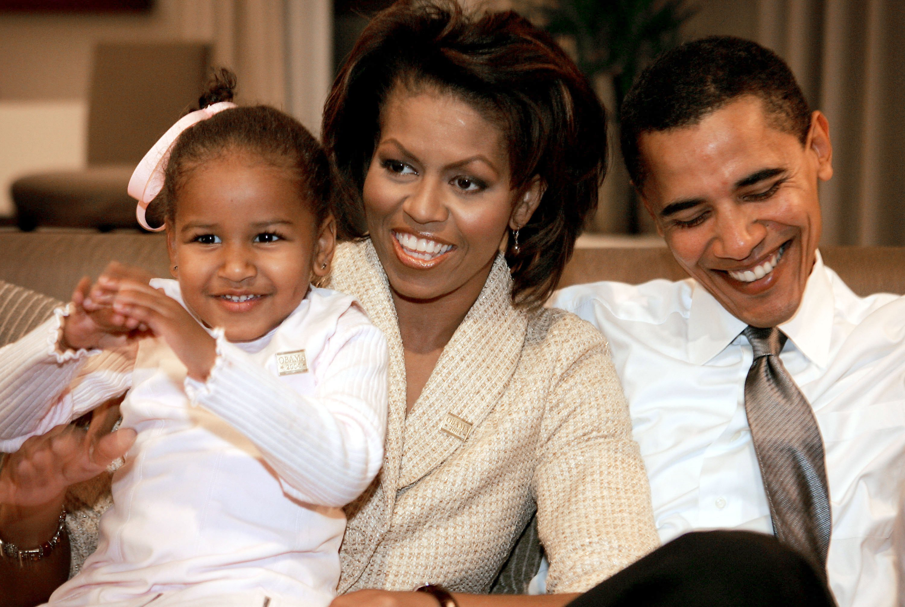 Michelle and Barack Obama and a young Sasha Obama | Photo: Getty Images