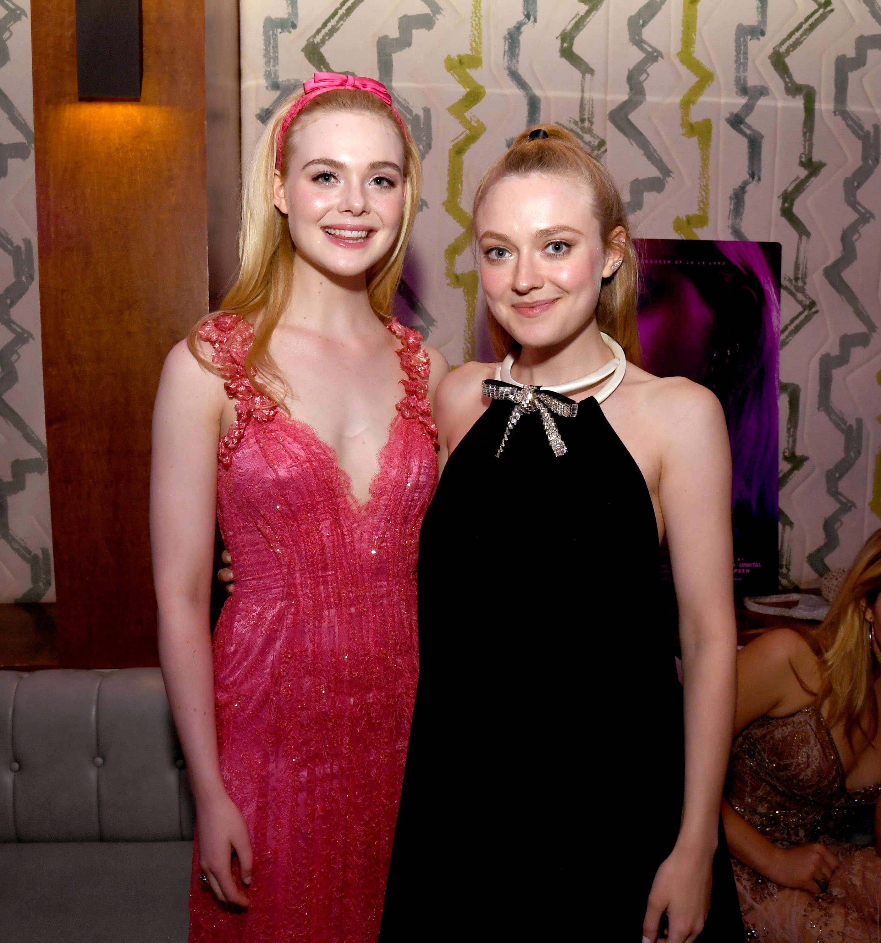 "Elle Fanning and Dakota Fanning pose at the after party for a special screening of Bleeker Street's ""Teen Spirit"" at the Highlight Room on April 02, 2019 in Hollywood, California 