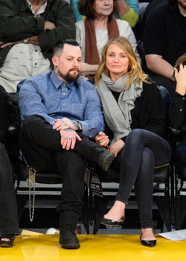 Benji Madden (L) and Cameron Diaz attend a basketball game between the Washington Wizards and the Los Angeles Lakers at Staples Center. | Photo: Getty Images