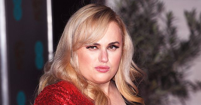 Rebel Wilson's New Workout Routine Involves a Giant Bottle of Alcohol — Check It Out
