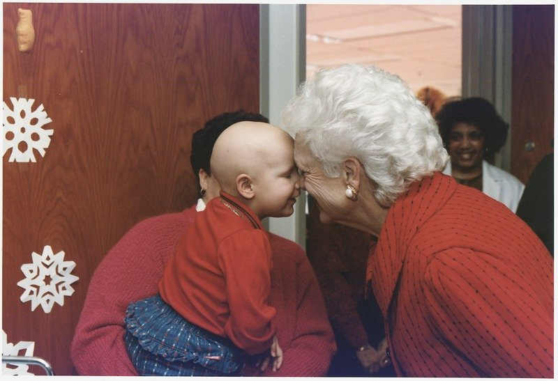 First Lady Barbara Bush visits patients at Children's Hospital in Washington, D.C., 1990   Source: Wikimedia