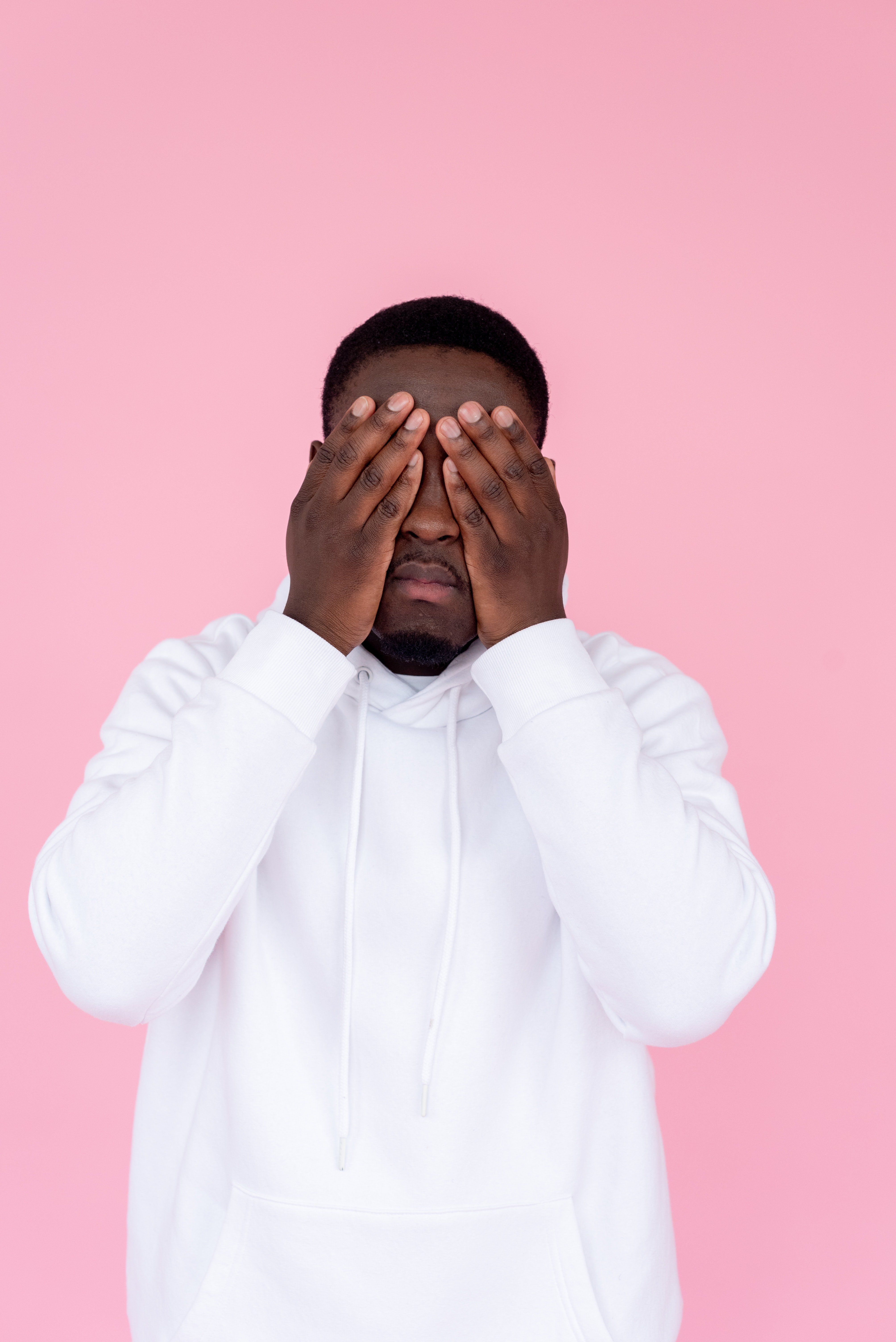 Sad black man covering his hands with face   Photo: Pexels