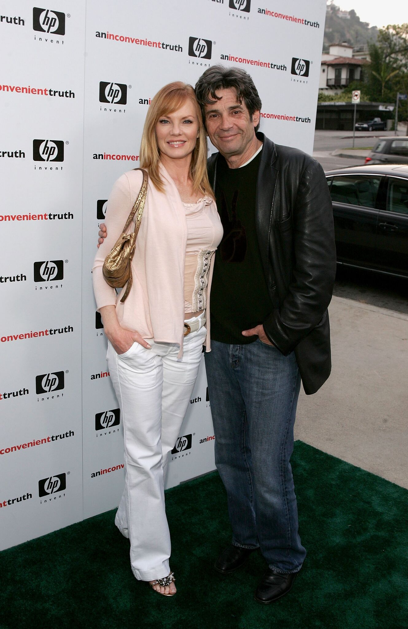 "Marg Helgenberger (L) and husband SAG President Alan Rosenberg arrive at the Los Angeles Premiere Of ""An Inconvenient Truth"" held at the DGA  