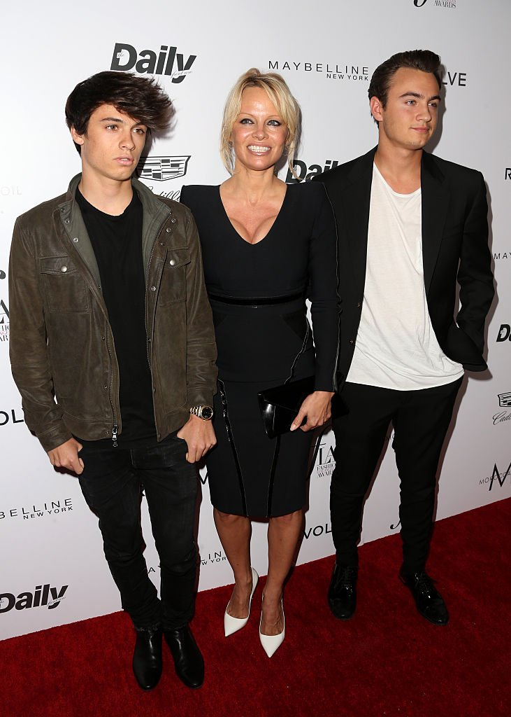 "Pamela Anderson and her sons Brandon Thomas Lee (R) and Dylan Jagger Lee at the ""Fashion Los Angeles Awards"" on March 20, 2016, in West Hollywood, California 