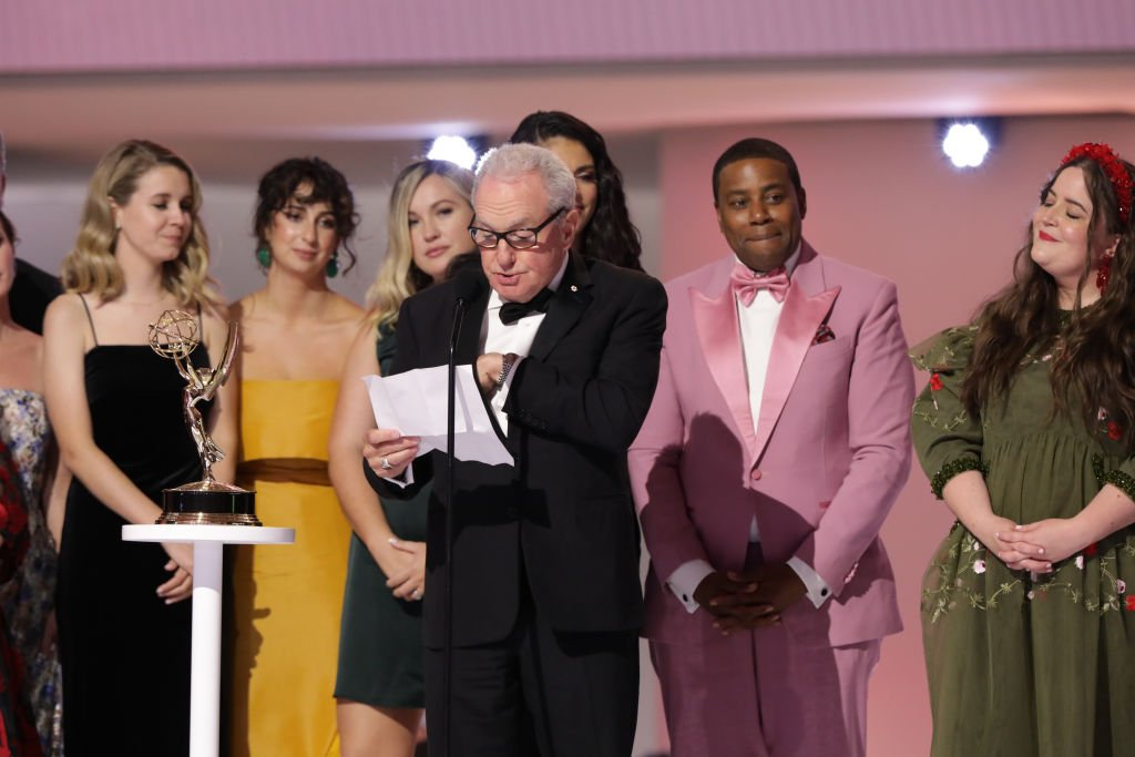 """Lorne Michaels and the cast of """"Saturday Night Live"""" onstage at the Emmy Awards, September 2021 