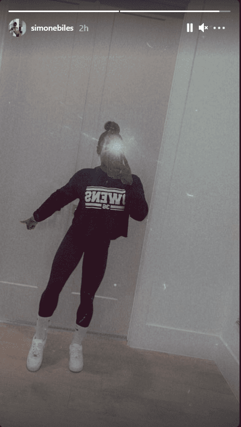 """Simone Biles wearing a sweater that says """"OWENS"""" which she posted on her Instagram Story. 