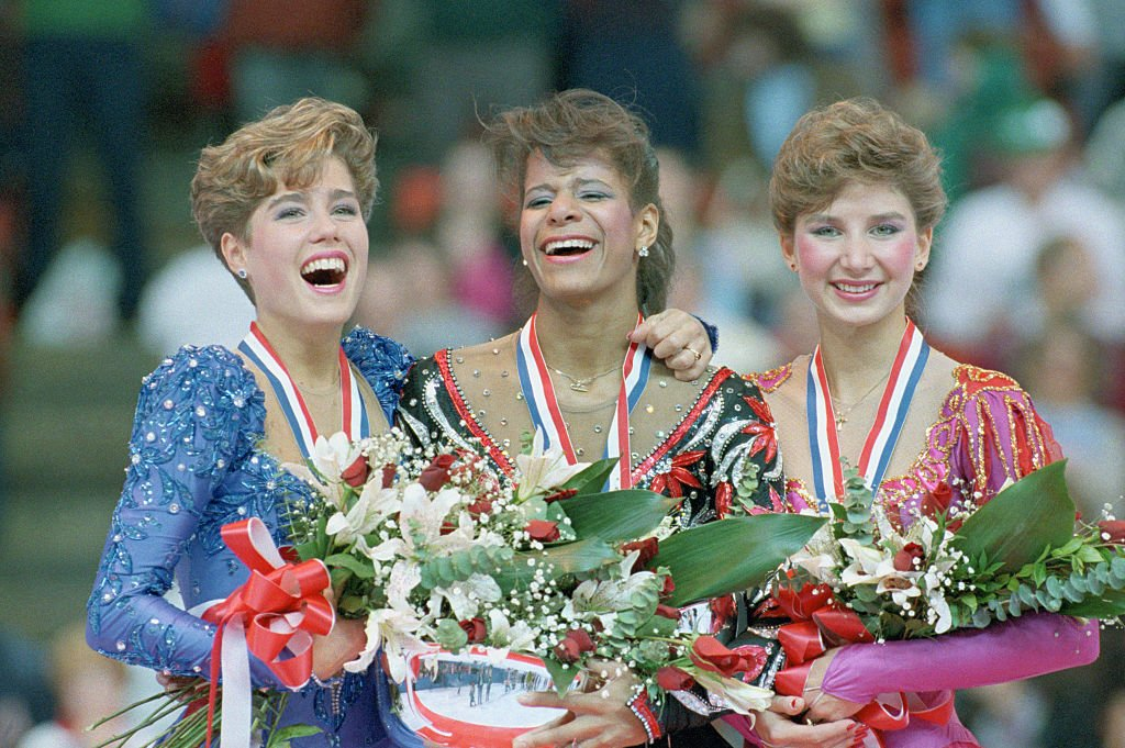 Jill Trenary, Debi Thomas and Caryn Kadavy fter capturing medals at the U.S. Figure Skating Championships in Denver, 1988 | Photo: GettyImages