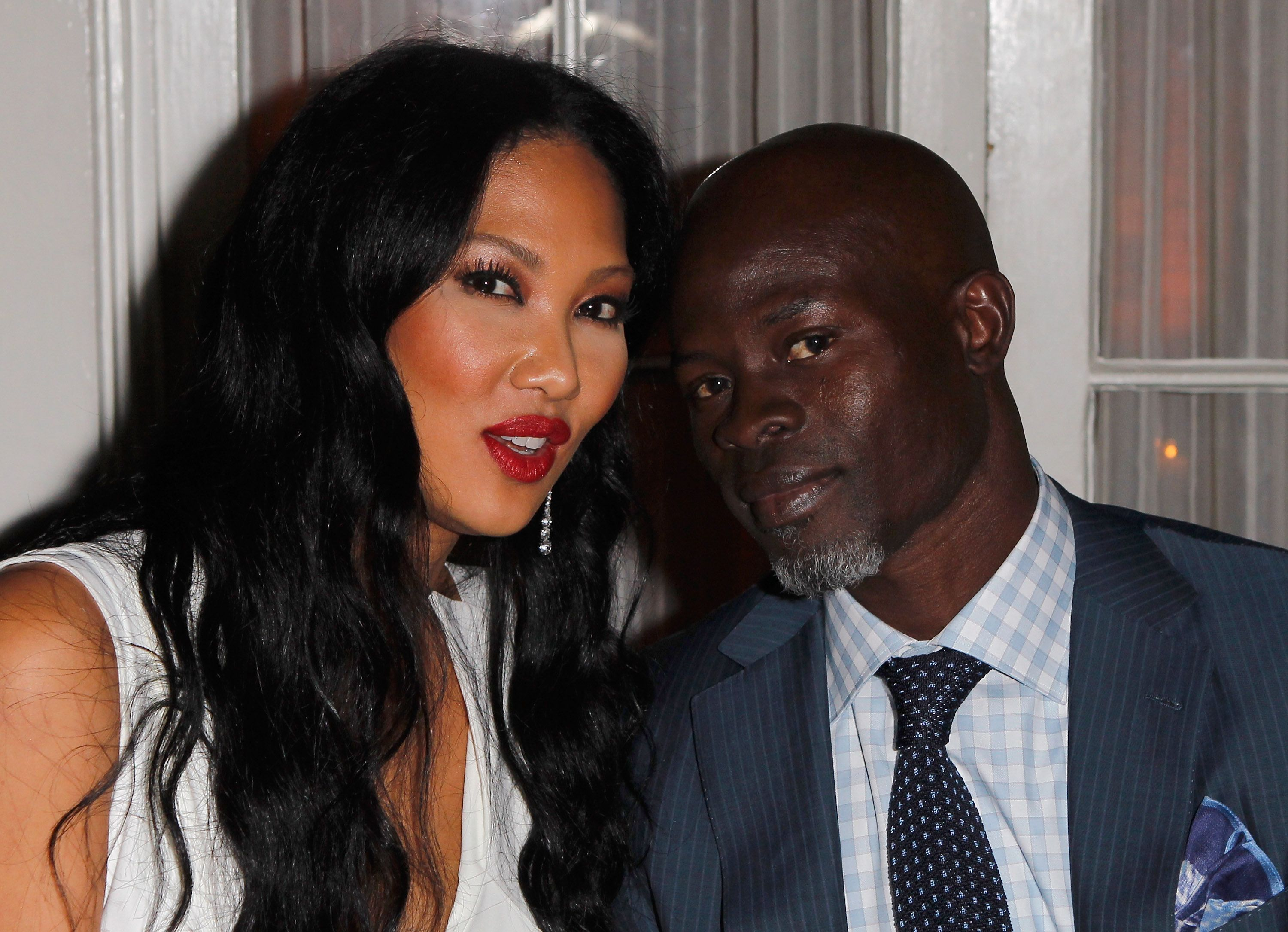 Kimora Lee Simmons and Djimon Hounsou at the Vanity Fair and Ermenegildo Zegna Dinner on February 22, 2012 in Los Angeles. | Photo: Getty Images