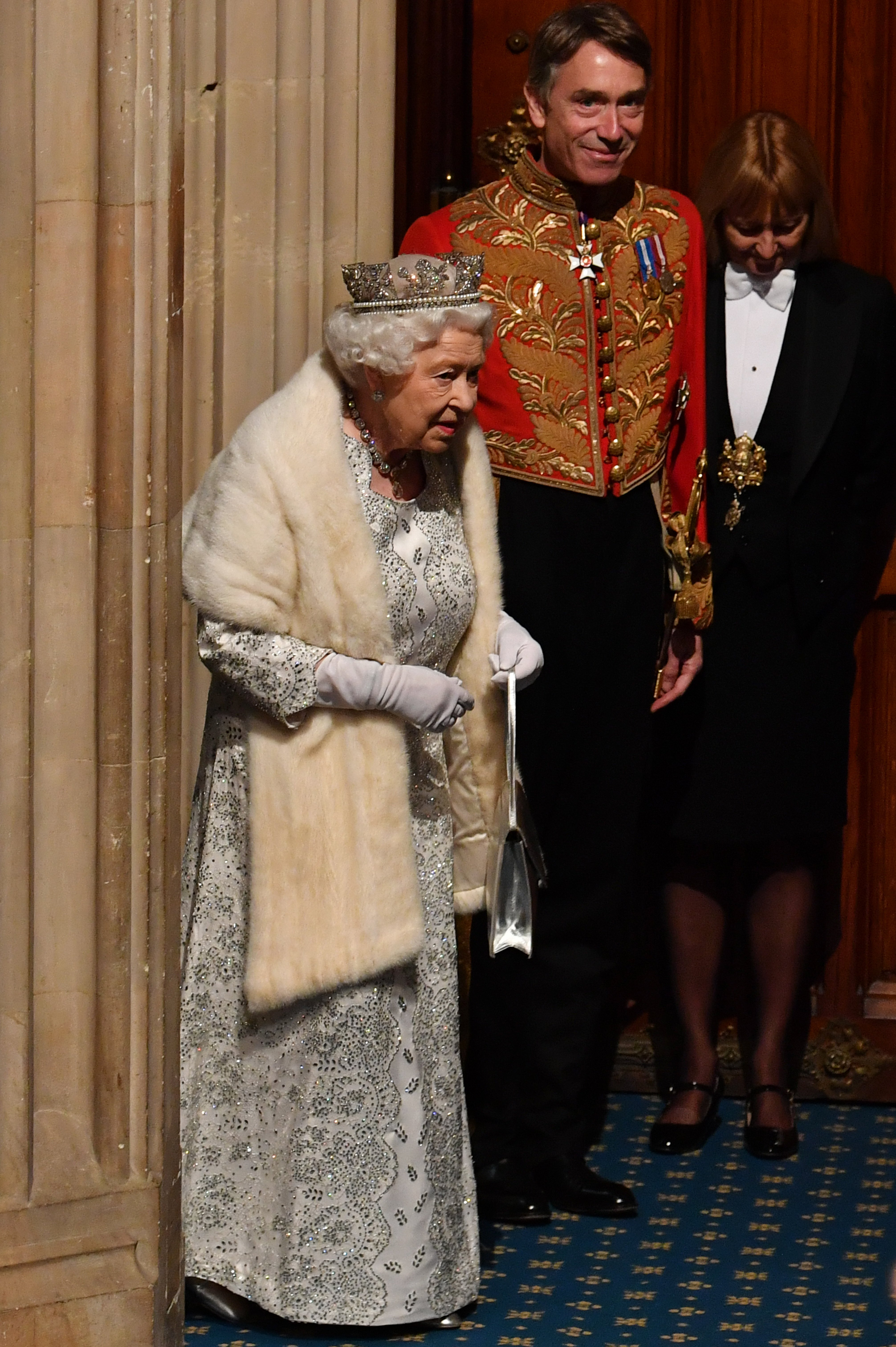 Queen Elizabeth II (L) arrives with David Cholmondeley, Marquess of Cholmondeley, (2L) to attend the State Opening of Parliament at the Palace of Westminster on October 14, 2019, in London, England. | Source: Getty Images.