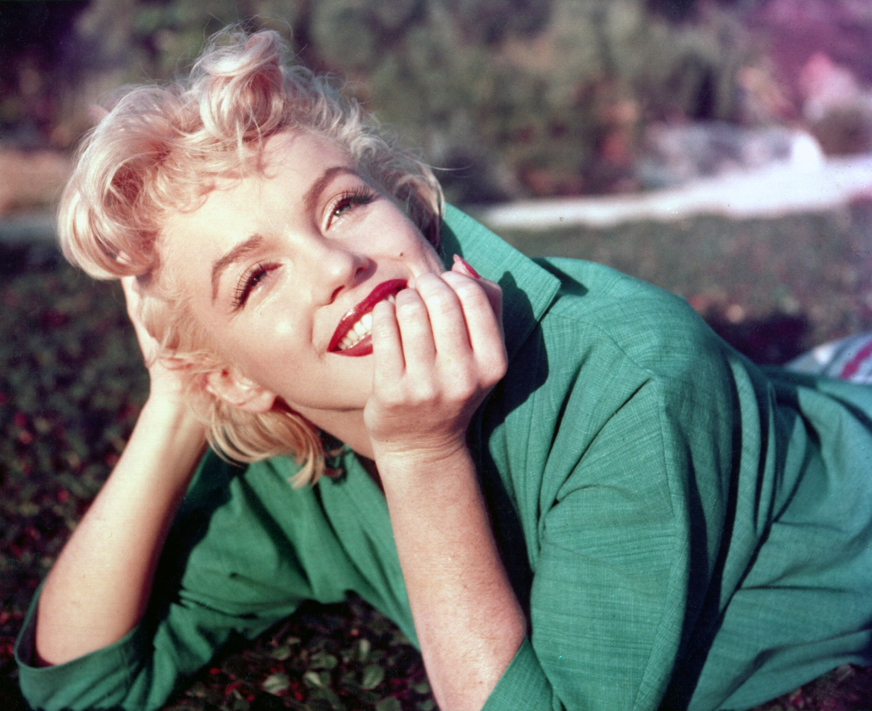Actress Marilyn Monroe poses for a portrait laying on the grass in 1954 in Palm Springs, California.   Source: Getty Images