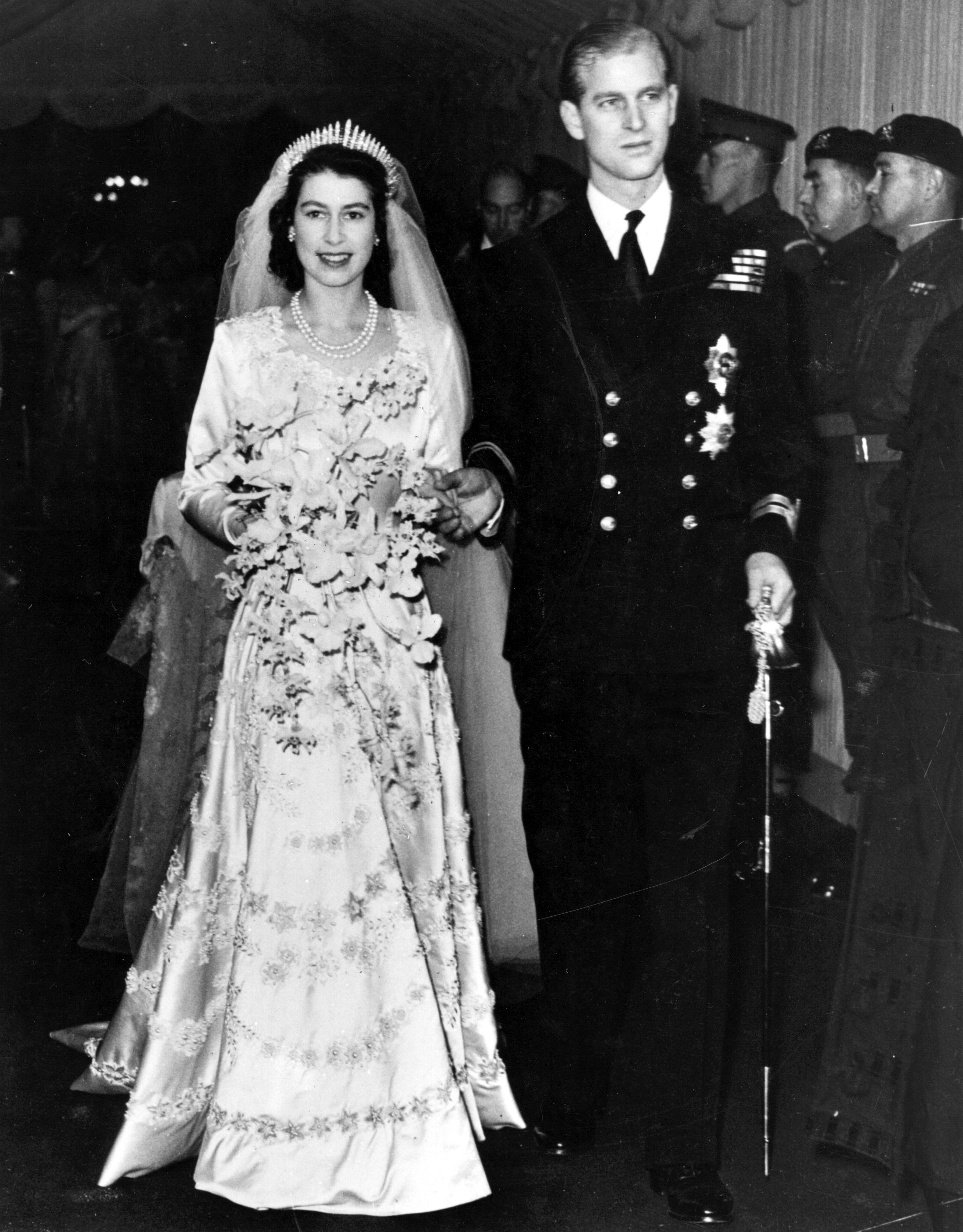 Queen Elizabeth and Prince Philip pictured at their wedding in 1947, London, England. | Photo: Getty Images