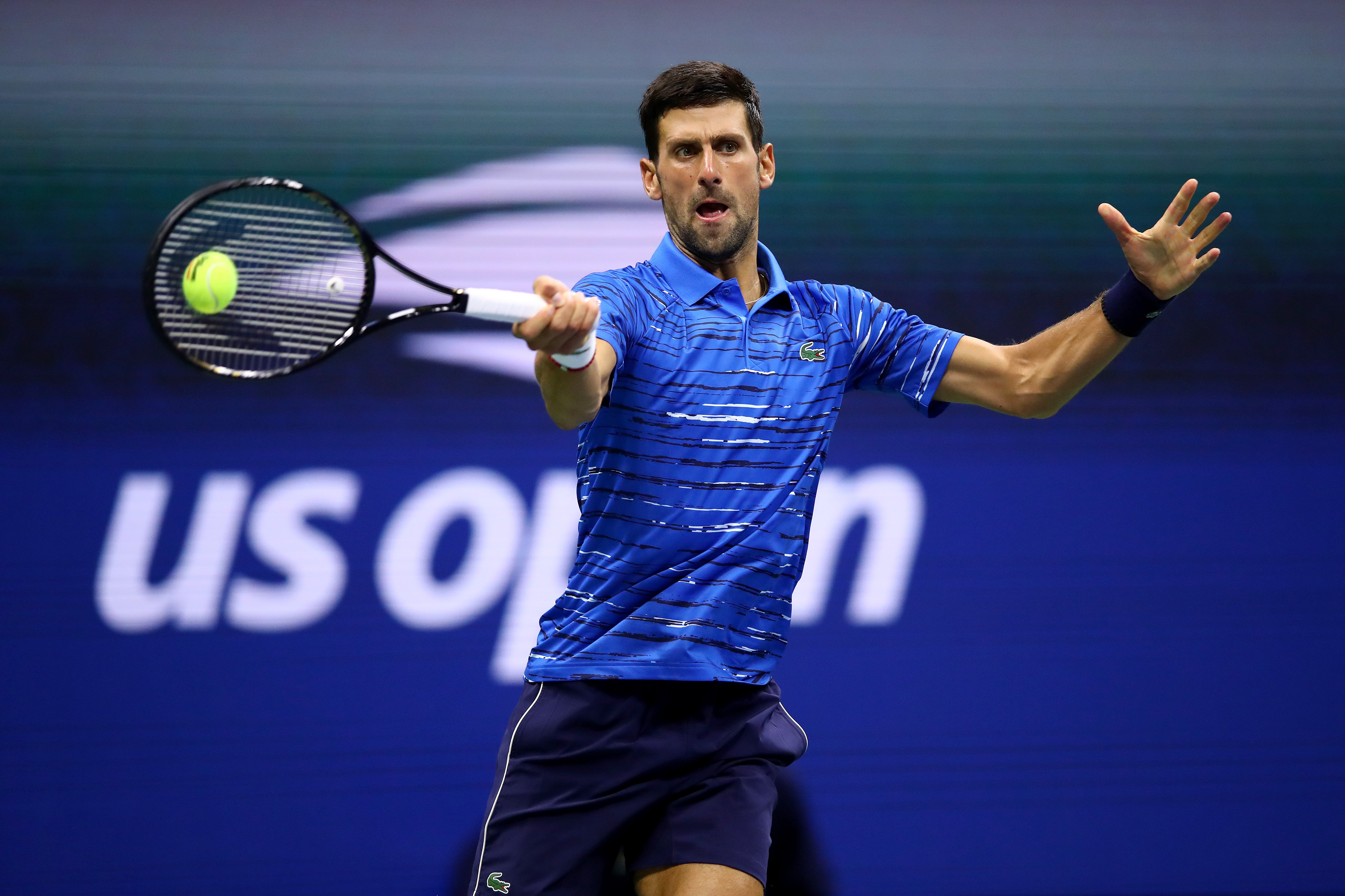 Novak Djokovic returns a shot during his Men's Singles second round match against Juan Ignacio Londero of Argentina on day three of the 2019 US Open. | Source: Getty Images.