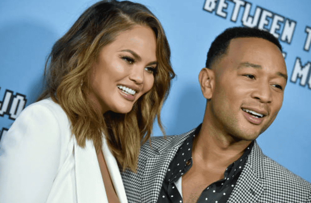 "Chrissy Teigen and John Legend pose on the red carpet for the premiere of Netflix's ""Between Two Ferns: The Movie,"" on September 16, 2019, in Hollywood, California 
