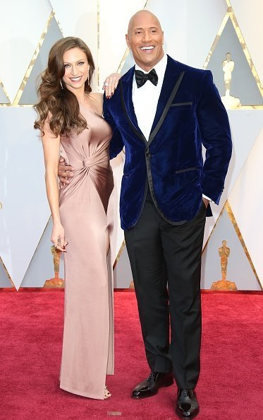 Actor Dwayne Johnson (R) and Lauren Hashian arrive at the 89th Annual Academy Awards at Hollywood & Highland Center on February 26, 2017 in Hollywood, California | Photo: Getty Images