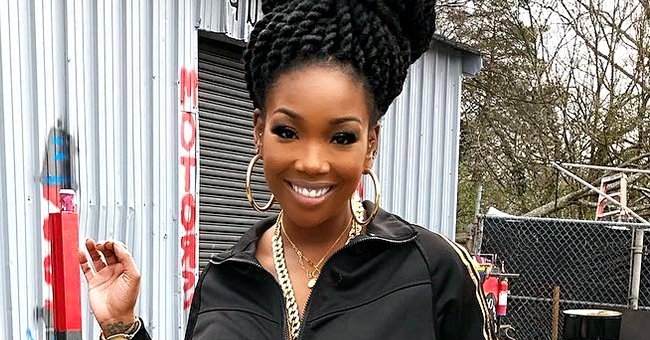 Singer Brandy Stuns in a Golden Dress While Rocking Her Natural Hair in a Recent Photo