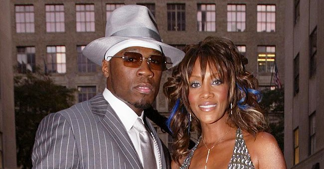 50 Cent's Ex Vivica A Fox Shows off Her Slim Legs Wearing a Black Dress with Stylish High Heels