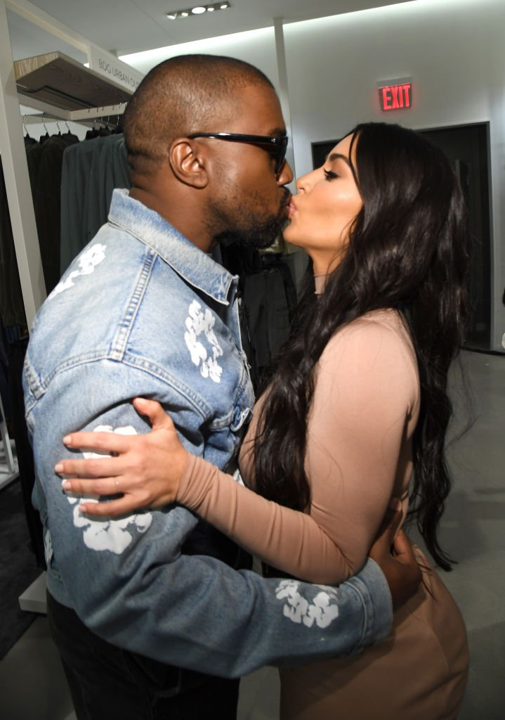 Kanye West and Kim Kardashian West share a kiss as they celebrate the launch of SKIMS at Nordstrom NYC on February 05, 2020 in New York City. | Photo: Getty Images