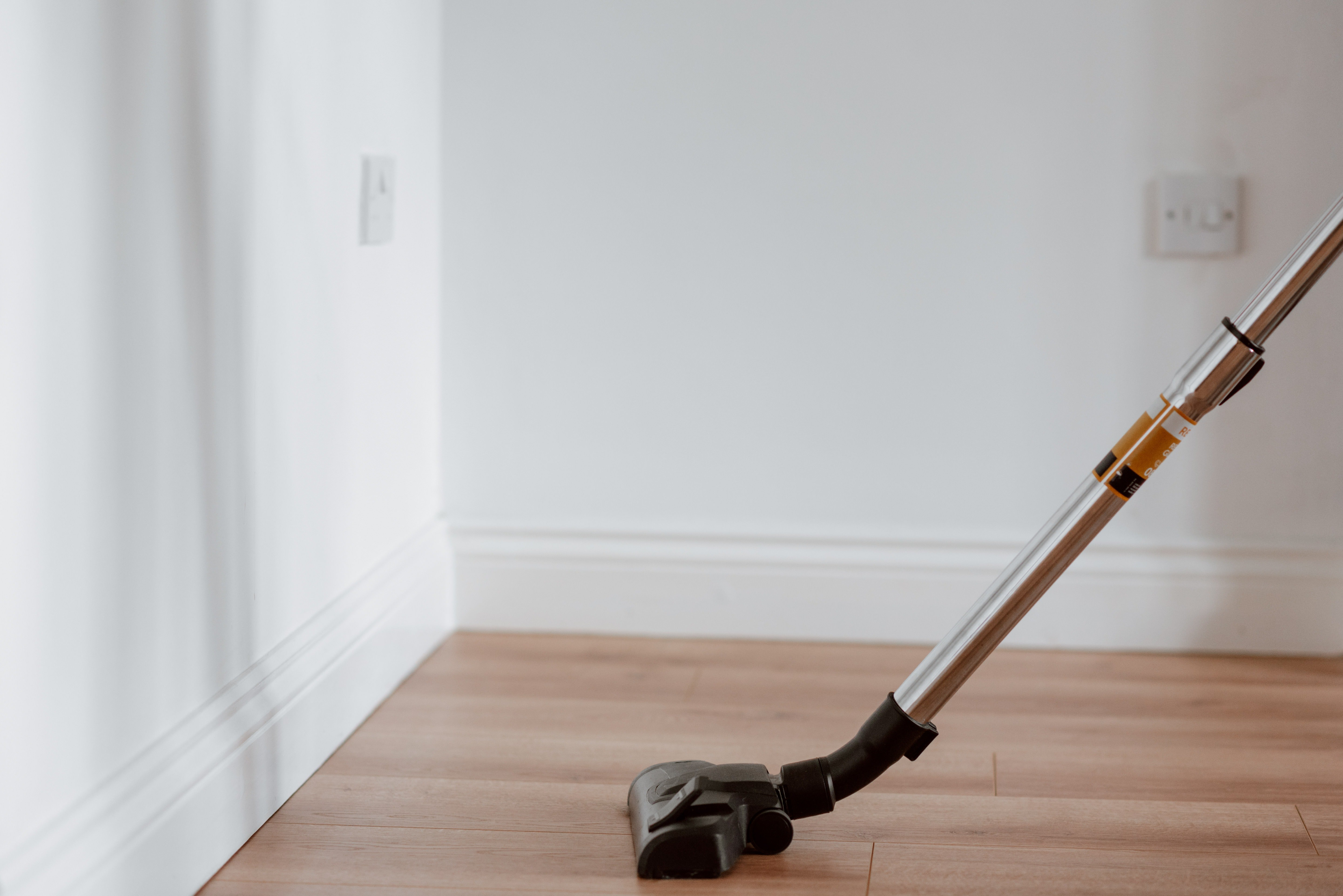A vacuum cleaner on a wooden floor.   Pexels/ Anete Lusina