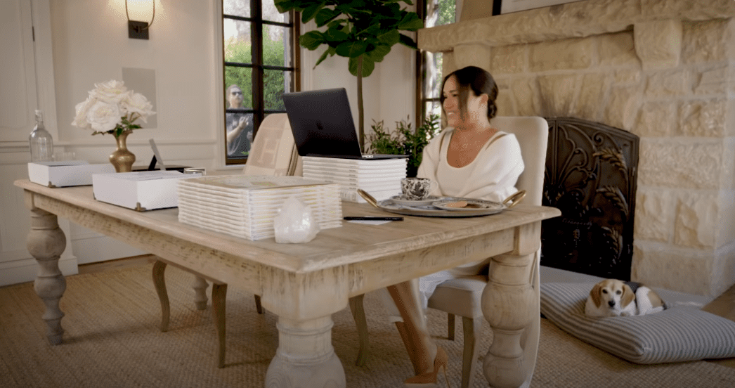 Meghan Markle in her home during an interview with Melissa McCarthy with Prince Harry seen in the background  Photo: YouTube/TODAY