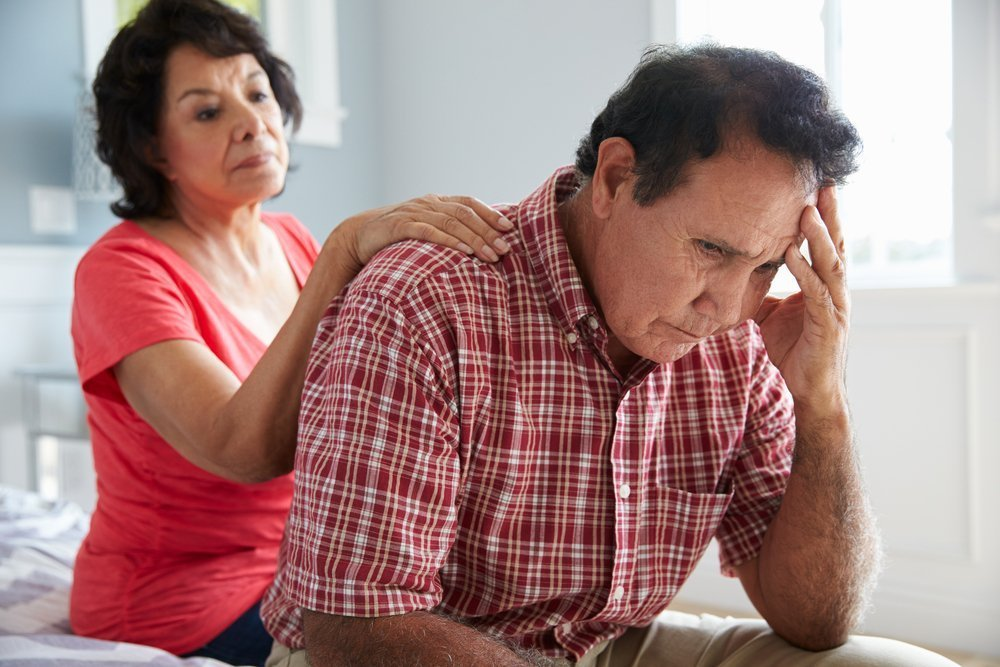 Wife Comforting Senior Husband Suffering With Dementia | Photo: Shutterstock