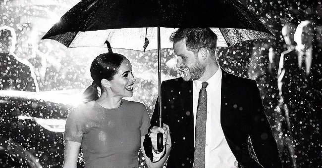 Meghan & Harry Photographed in the Rain & Pic Looks like It Was Taken Straight out of a Movie