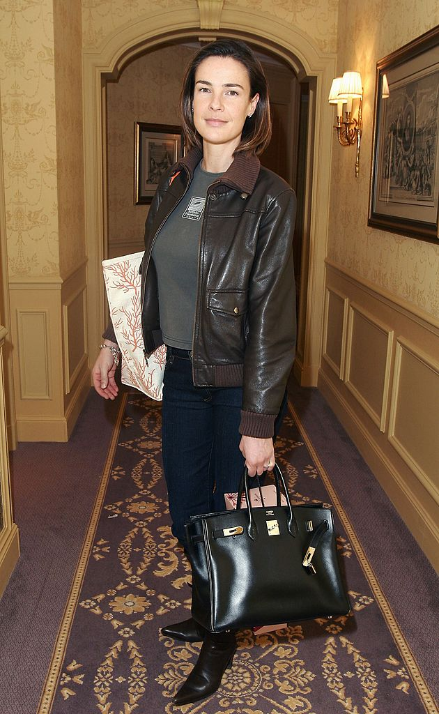 """Benedicte Delmas poses for photographs inside the """"Espace Glamour Chic"""", the first gift lounge organized at the George V hotel February 23, 2006 in Paris. 