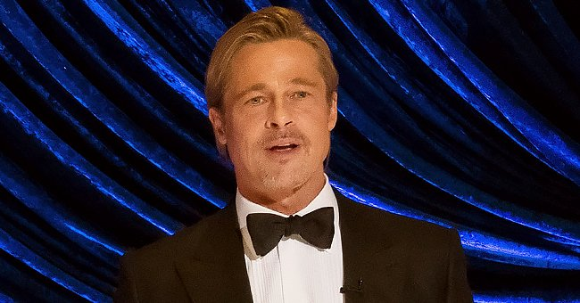 Brad Pitt Spotted at the Oscars Rocking a Little Ponytail & Stylish Black Tuxedo — See His Look