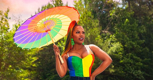 Kandi Burruss Slays in a Rainbow Suit and Matching Umbrella in Celebration of Pride Month