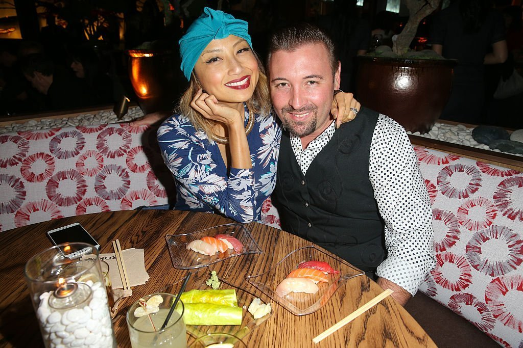Jeannie Mai and Freddy Harteis at the grand opening of Roku on November 2015. | Photo: Getty Images