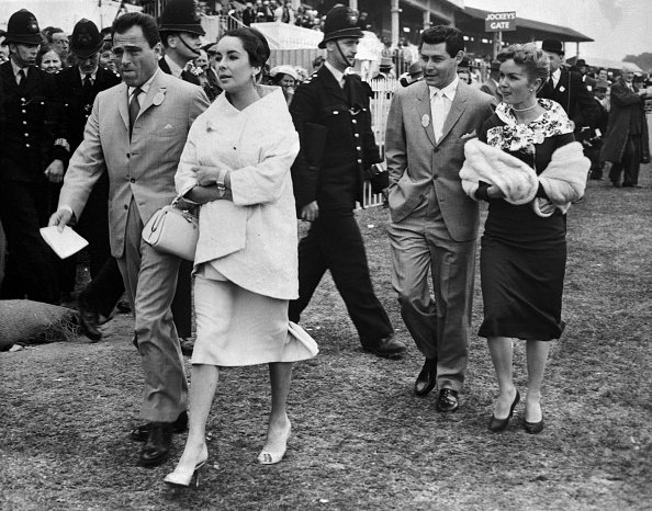 Elizabeth Taylor, Mike Todd, Eddie Fisher, and Debbie Reynolds on June 5, 1957 as they attended the running of the English Derby in Epsom. | Photo: Getty Images