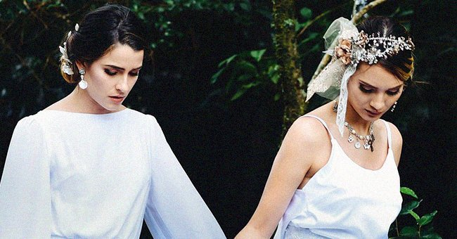 A bride looks downcast as she holds the hand of her bridesmaid who also has a frown on her face   Photo: Pixabay/Photosbychalo