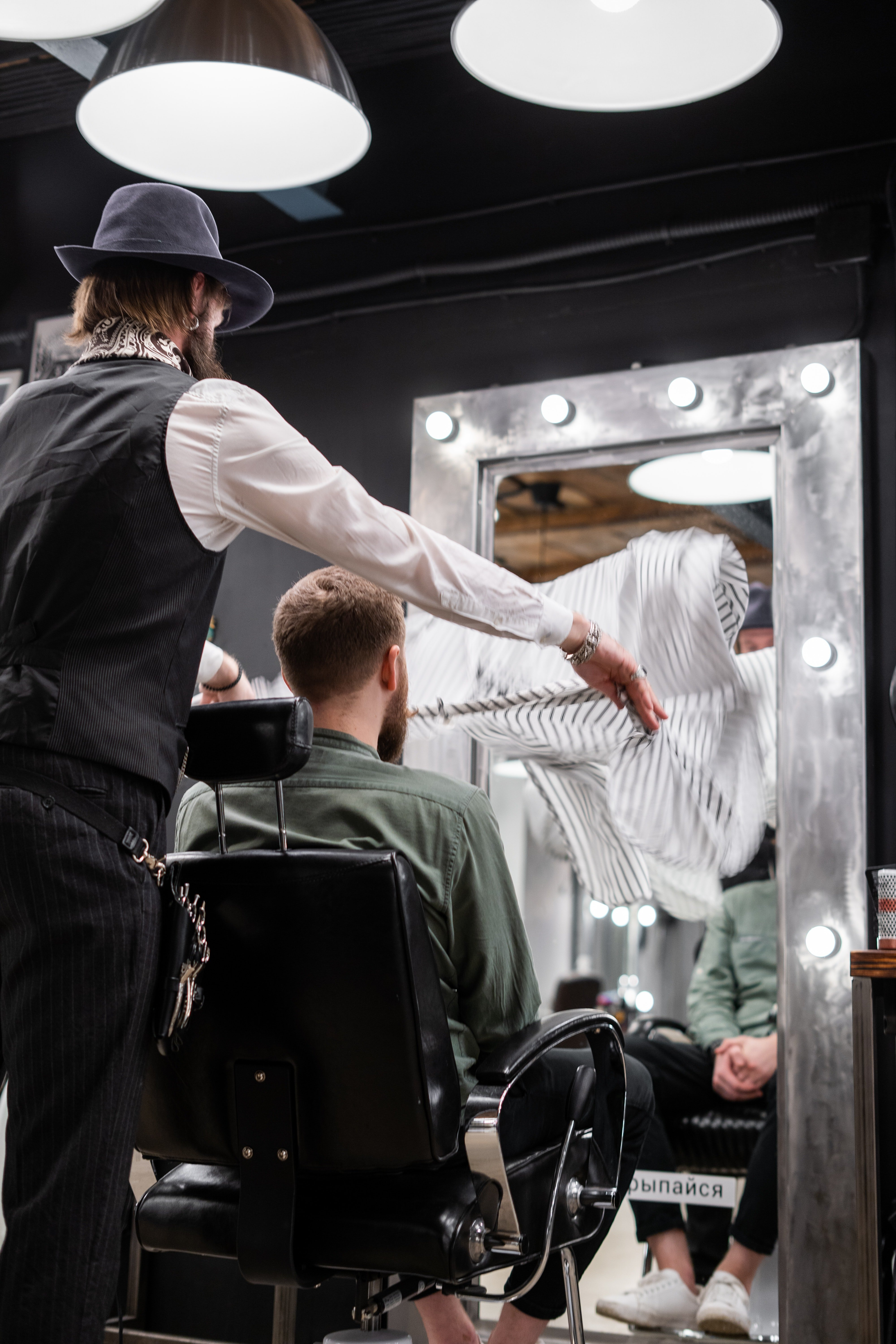 The barber offered the businessman a seat, and asked him about the haircut he wanted this time.   Photo: Pexels/cottonbro
