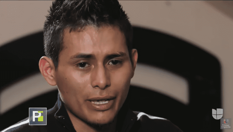 Yovany Lopez prays for his son to recover. | Source: YouTube/Primer Impacto