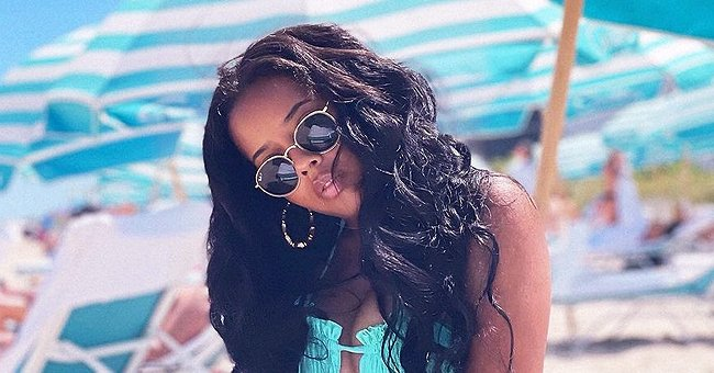 Angela Simmons Leaves Little to the Imagination Posing on a Beach in an Itty-Bitty Blue Bikini