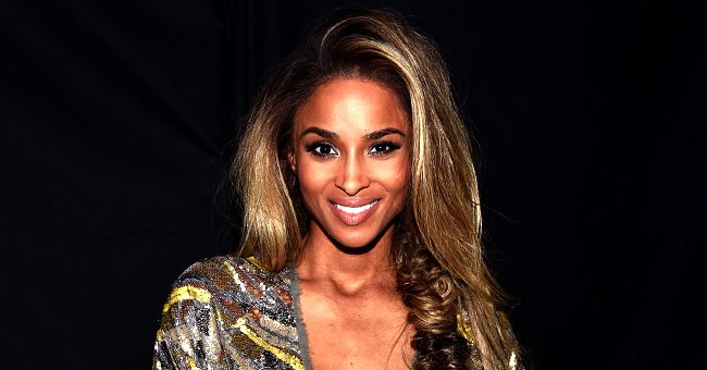 Ciara Flaunts Growing Baby Bump in Form-Fitting One-Shoulder Dress with High Slit at Tom Ford Fashion Show