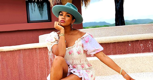 LeToya Luckett Enjoys the Sun in Floral Off-Shoulder Dress & Hat during Mexican Escapade