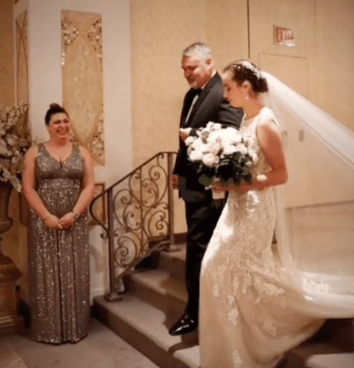 Bride and her donor father walk through the wedding venue arm in arm   Photo: TikTok/thebionicbuffalobeauty