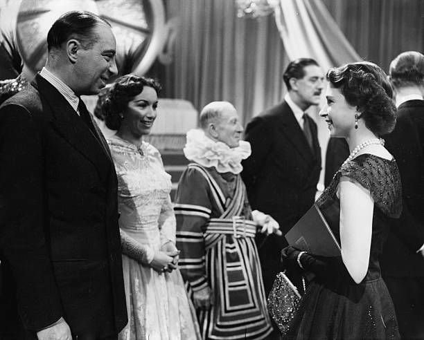 Queen Elizabeth II meets actors Bill Fraser and Pat Kirkwood during her tour of the BBC television Studios. | Source: Getty Images