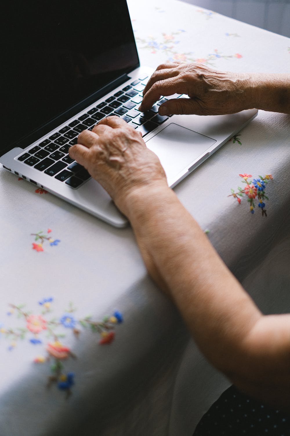 Hands typing on a computer. | Source: Pexels