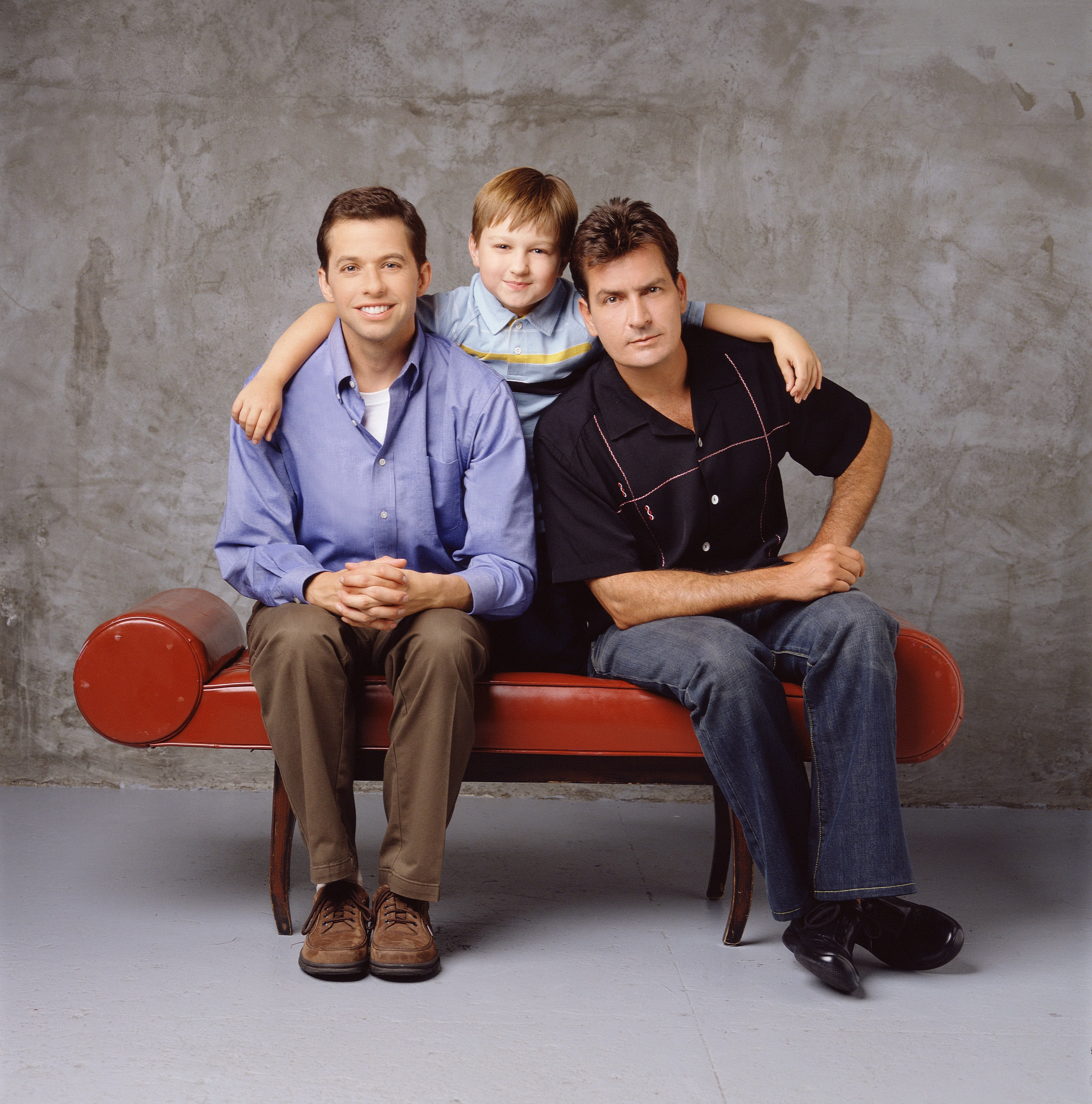 Promotional portrait of, from left, American actors Jon Cryer, Angus T. Jones, and Charlie Sheen for the television comedy 'Two and a Half Men,' Los Angeles, California, 2003.   Source: Getty Images
