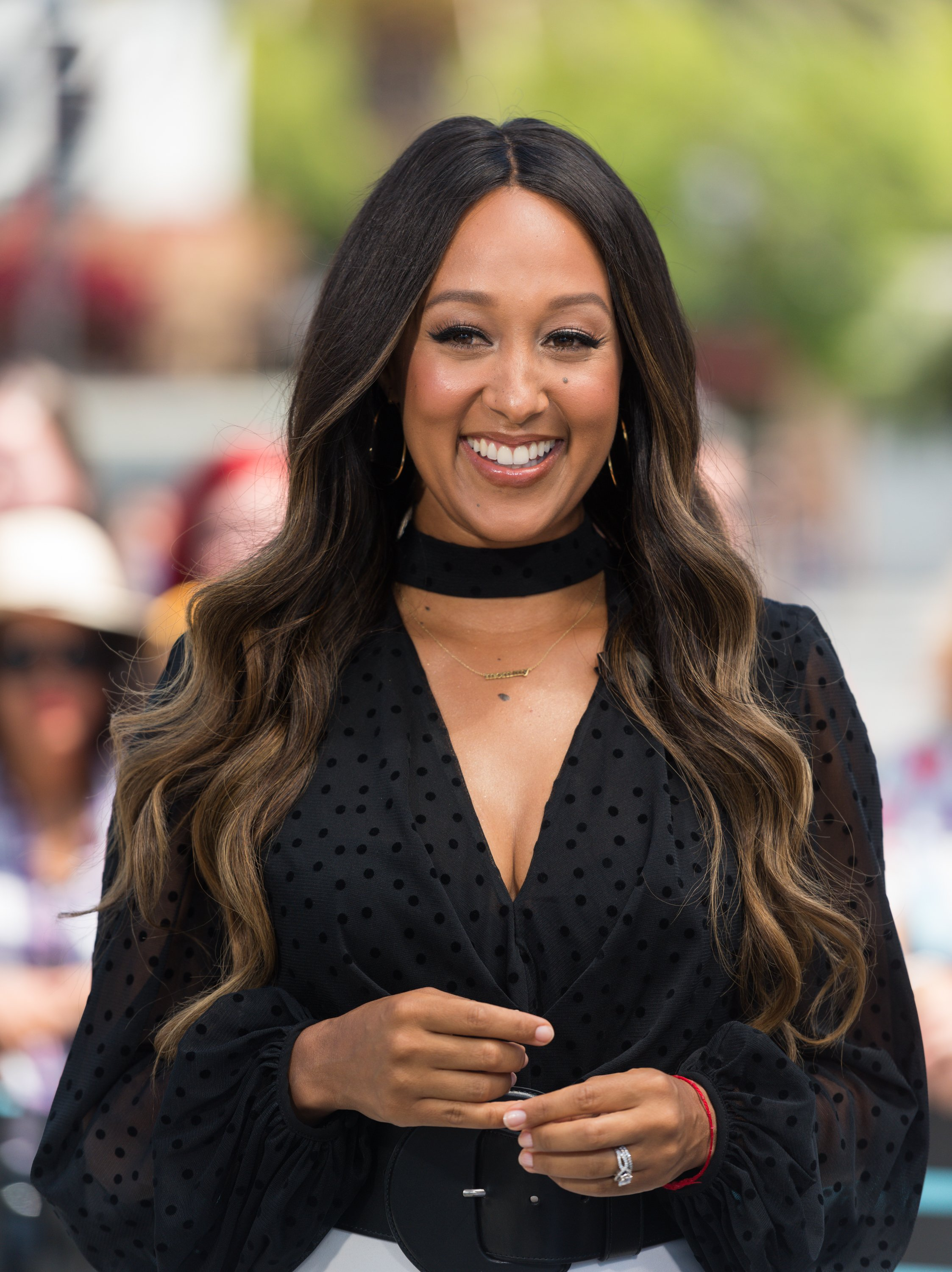 "Tia Mowry visiting ""Extra"" in August 2017. 