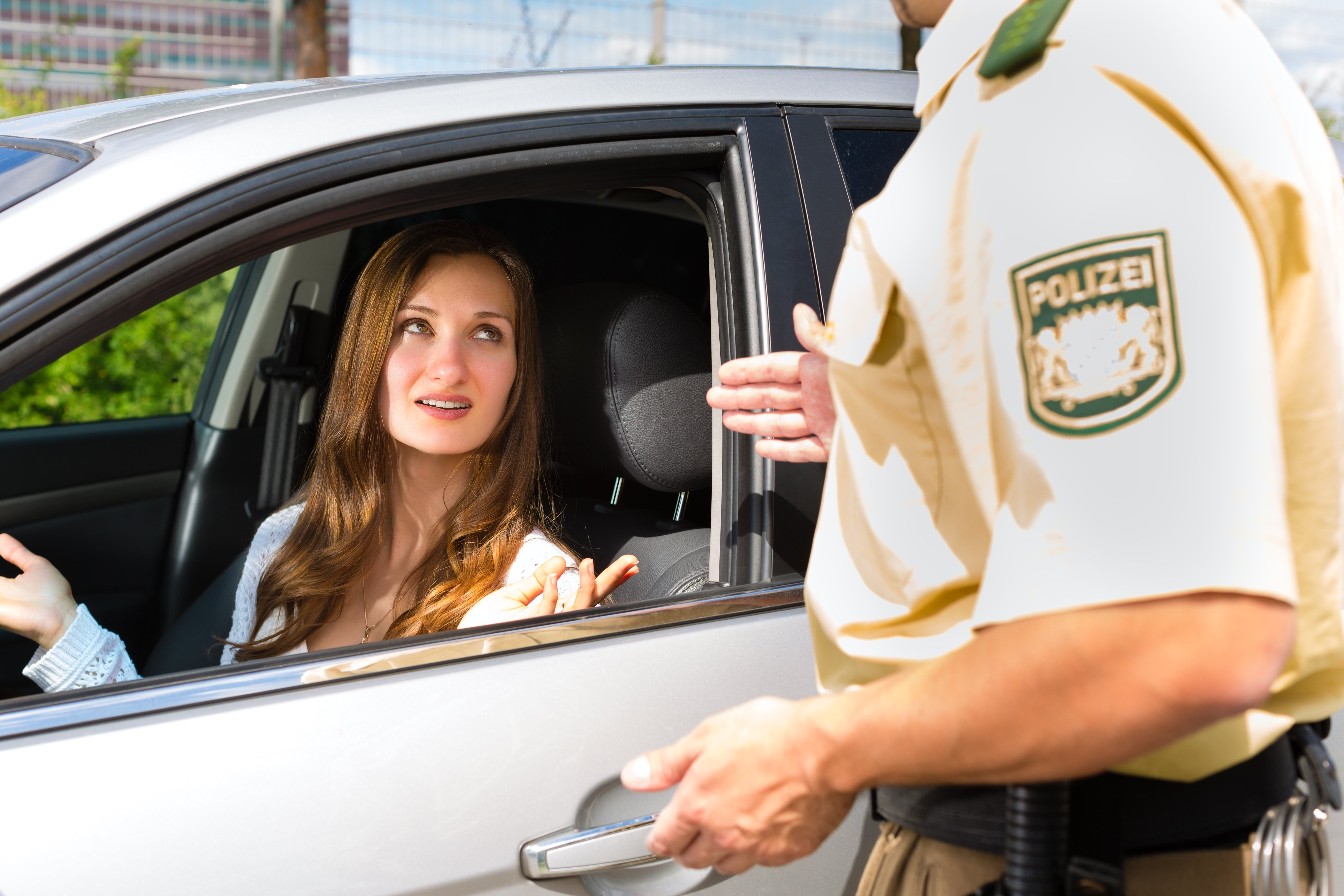 Policeman and a young woman conversing | Photo: Shutterstock.com