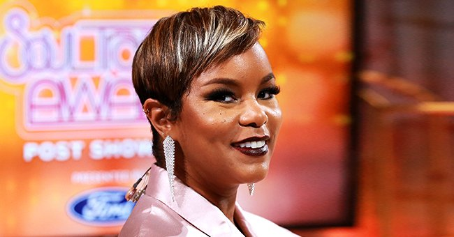 LeToya Luckett Celebrates Getting Back to Pre-Baby Weight with Photos of Herself in Black Leather Romper & Boots