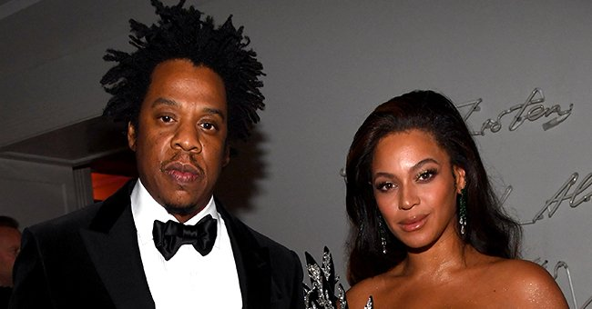 Beyoncé Stuns in Gown with Gold Statement Sleeves as She & Jay-Z Make Surprise Appearance at 2020 Golden Globes