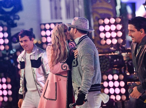 enny McCarthy and Donnie Wahlberg kiss on stage during New Year's Eve 2019 in Times Square on December 31, 2018 in New York City | Photo: Getty Images